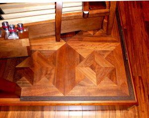 A parquet floor with rhomboid motifs.