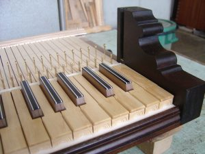 This elegant keyboard is a reconstruction copied from an organ built by Zavarise in 1785. The diatonic key coverings are made from boxwood with carved key fronts, while the chromatic keys are made from walnut covered with ebony. The longitudinal inserts are cow bone.
