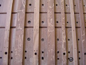 Detail of an eighteenth century windchest after filling of the woodworm holes has been completed.