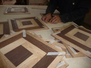 The manufacturing of an oak and African wengé parquet floor.
