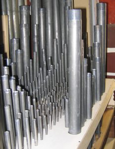 This shows the same pipes in their proper positions after restoration. Many of their resonators have been lengthened with homogeneous material to restore their original pitch and temperament.
